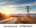 high voltage tower in mountains ... | Shutterstock . vector #379865662