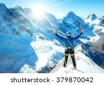mountaineer reaches the top of... | Shutterstock . vector #379870042