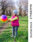 cute little girl playing ball | Shutterstock . vector #379880998