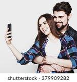 loving couple making selfie  | Shutterstock . vector #379909282