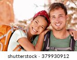 happy young hikers backpacking... | Shutterstock . vector #379930912