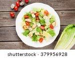 fresh healthy salad on wooden... | Shutterstock . vector #379956928