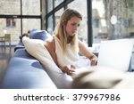 gorgeous young woman watching... | Shutterstock . vector #379967986