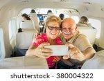 senior happy couple taking... | Shutterstock . vector #380004322