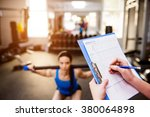 woman exercising in gym ... | Shutterstock . vector #380064898
