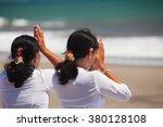 Two Asian Women With Praying...