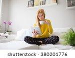 reading an interesting article | Shutterstock . vector #380201776