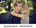 romantic couple hugging in park ... | Shutterstock . vector #380203042