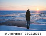 Girl Standing On A Frozen Lake...