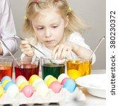 portrait of little girl during... | Shutterstock . vector #380230372