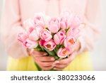 bunch of tulips in woman's...   Shutterstock . vector #380233066