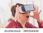happy woman using virtual...   Shutterstock . vector #380266606