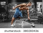muscular man working out in gym ...   Shutterstock . vector #380283436