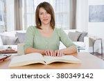 blind woman reading braille | Shutterstock . vector #380349142