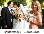 bride and groom kissing in the... | Shutterstock . vector #380368336
