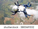 skydivers make a star formation ... | Shutterstock . vector #380369332