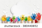Stock photo colorful painted hands in front of a decorated wall with a flower and butterflies 380440852