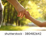 a the parent holds the hand of...   Shutterstock . vector #380482642