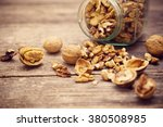 walnuts on rustic old wooden... | Shutterstock . vector #380508985