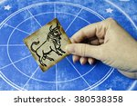hand holding a card with sign...   Shutterstock . vector #380538358
