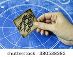 hand holding a card with sign... | Shutterstock . vector #380538382