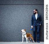 Stock photo businessman with his dog 380542846