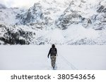 Girl Hiking Frozen Lake. Winte...