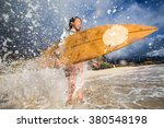 a surfing girl on a beach ready ... | Shutterstock . vector #380548198