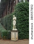 an antique statue by tree lined ... | Shutterstock . vector #380557852