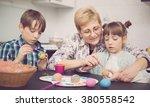 grandmother with grandchildren... | Shutterstock . vector #380558542