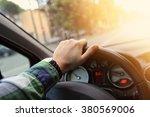 driver drives a car | Shutterstock . vector #380569006