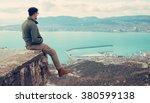 traveler young man sitting over ... | Shutterstock . vector #380599138