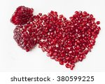 pomegranate seeds in heart... | Shutterstock . vector #380599225