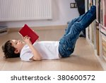 little boy child reading a book ... | Shutterstock . vector #380600572