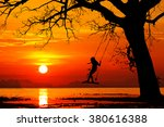 happy child swinging at... | Shutterstock . vector #380616388