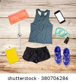 sports outfit and equipment on... | Shutterstock . vector #380706286