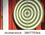 old darts target hanging on red ... | Shutterstock . vector #380770366