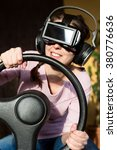 woman with a driving simulator... | Shutterstock . vector #380776636