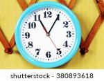 wall clock on the wood... | Shutterstock . vector #380893618