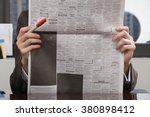 person looking at newspaper | Shutterstock . vector #380898412