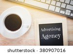 Small photo of Concept Advertising Agency message on wood boards. A keyboard and a glass coffee table.Vintage tone.