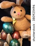 Small photo of Easter bunny with easter eggs