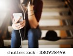 woman listening music media... | Shutterstock . vector #380928496