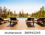 empty chair around swimming... | Shutterstock . vector #380942245