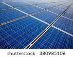 solar panels on the blue sky... | Shutterstock . vector #380985106