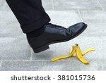Business Man Stepping On Banan...