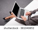 Business Woman Using Laptop...