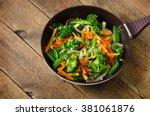 vegetable stir fry. healthy... | Shutterstock . vector #381061876