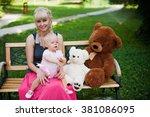 beautiful happy mother hugging... | Shutterstock . vector #381086095