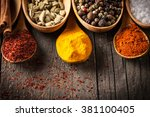 spices. spice in wooden spoon.... | Shutterstock . vector #381100405